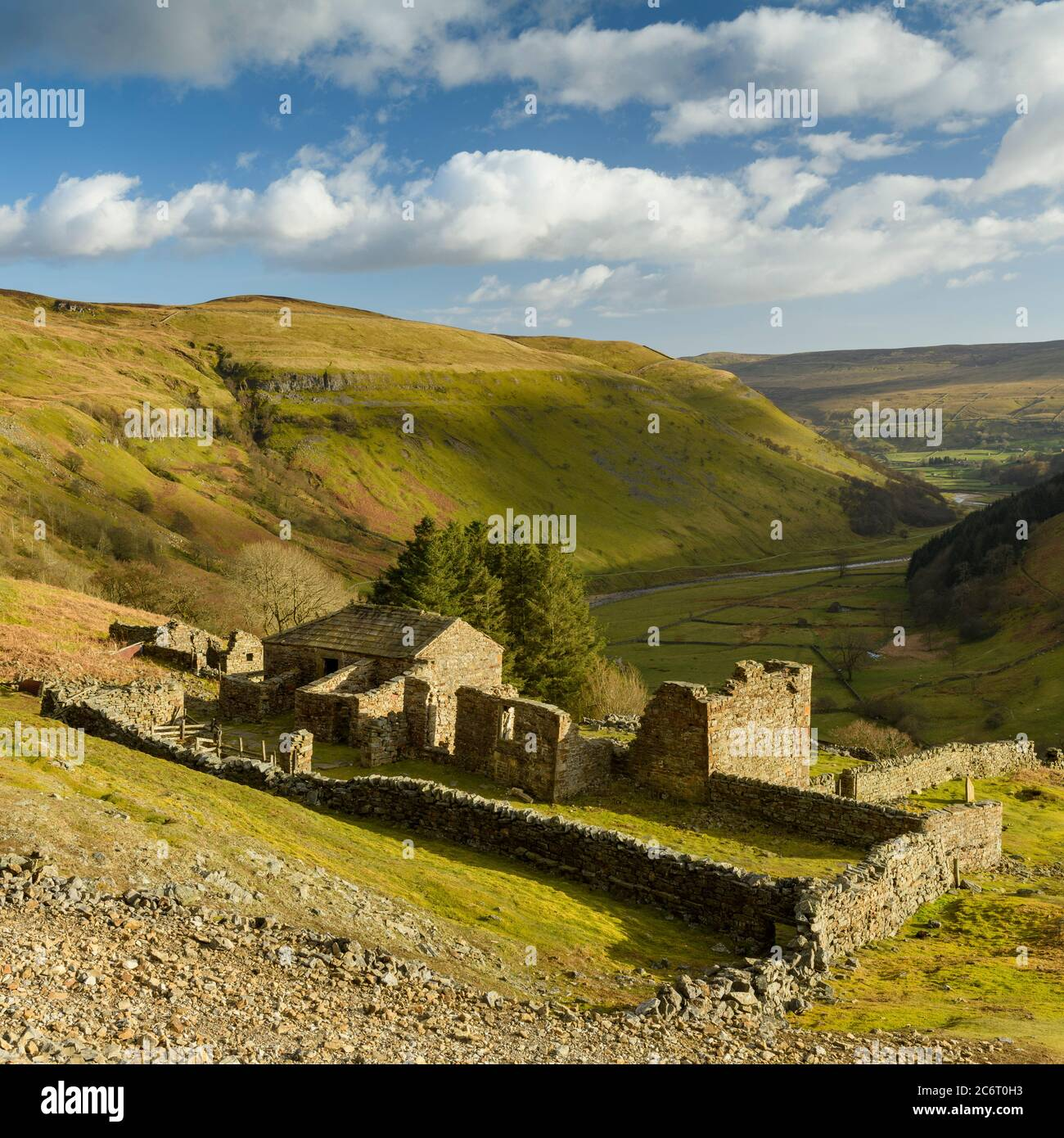 Crackpot Hall (old farmhouse ruins) high on remote sunlit hillside overlooking scenic rural Yorkshire Dales hills & valley (Swaledale) - England, UK. Stock Photo