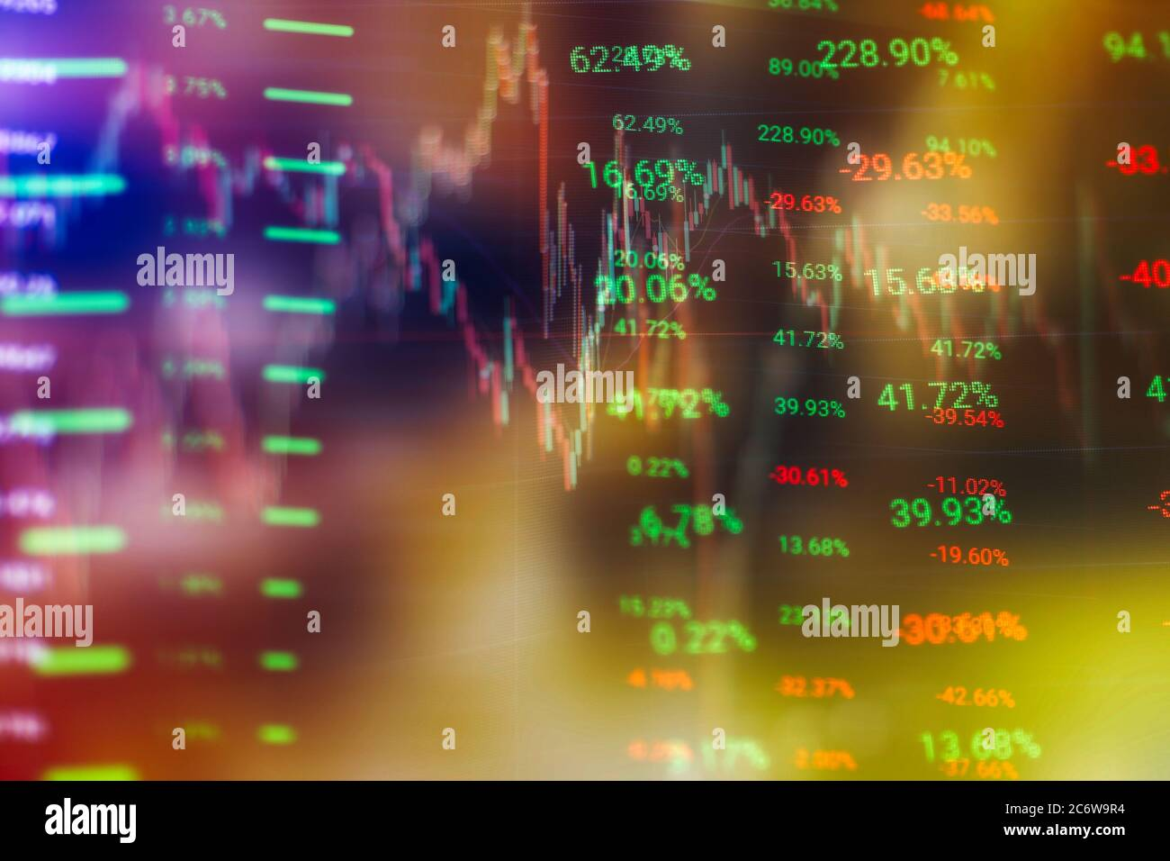 Concept of stock market and fintech. Blurry blue digital charts over dark blue background. Futuristic financial interface. Stock Photo