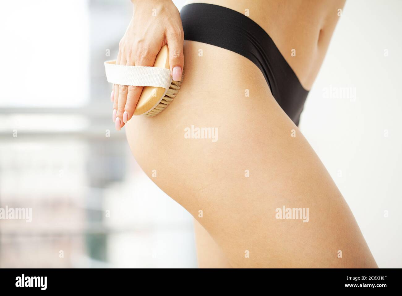 Cellulite Treatment Woman Arm Holding Dry Brush To Top Of Her Leg Stock Photo Alamy