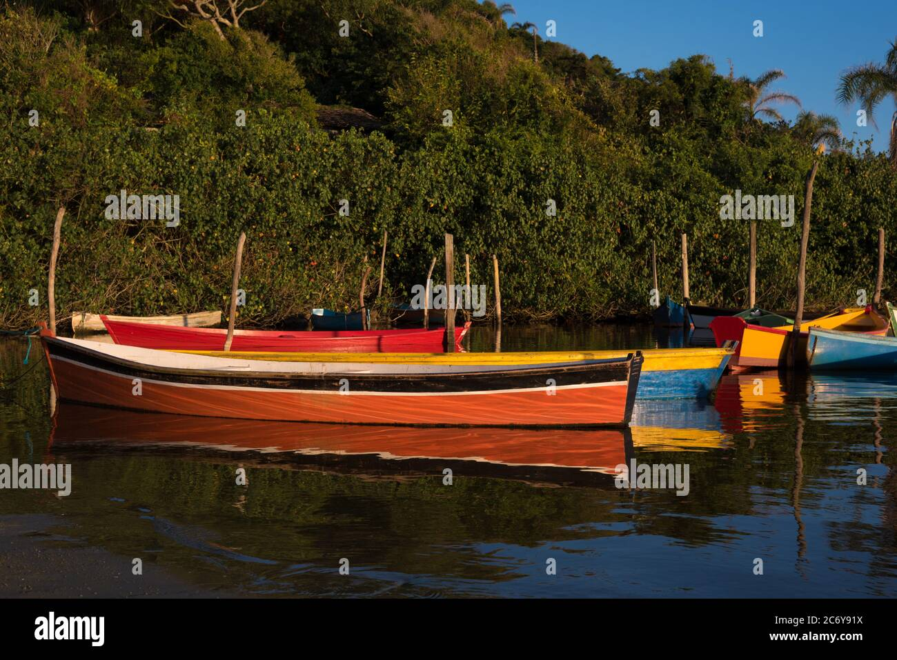 Rowing boats used to transport tourists at Guarda do Embaú Beach Stock Photo