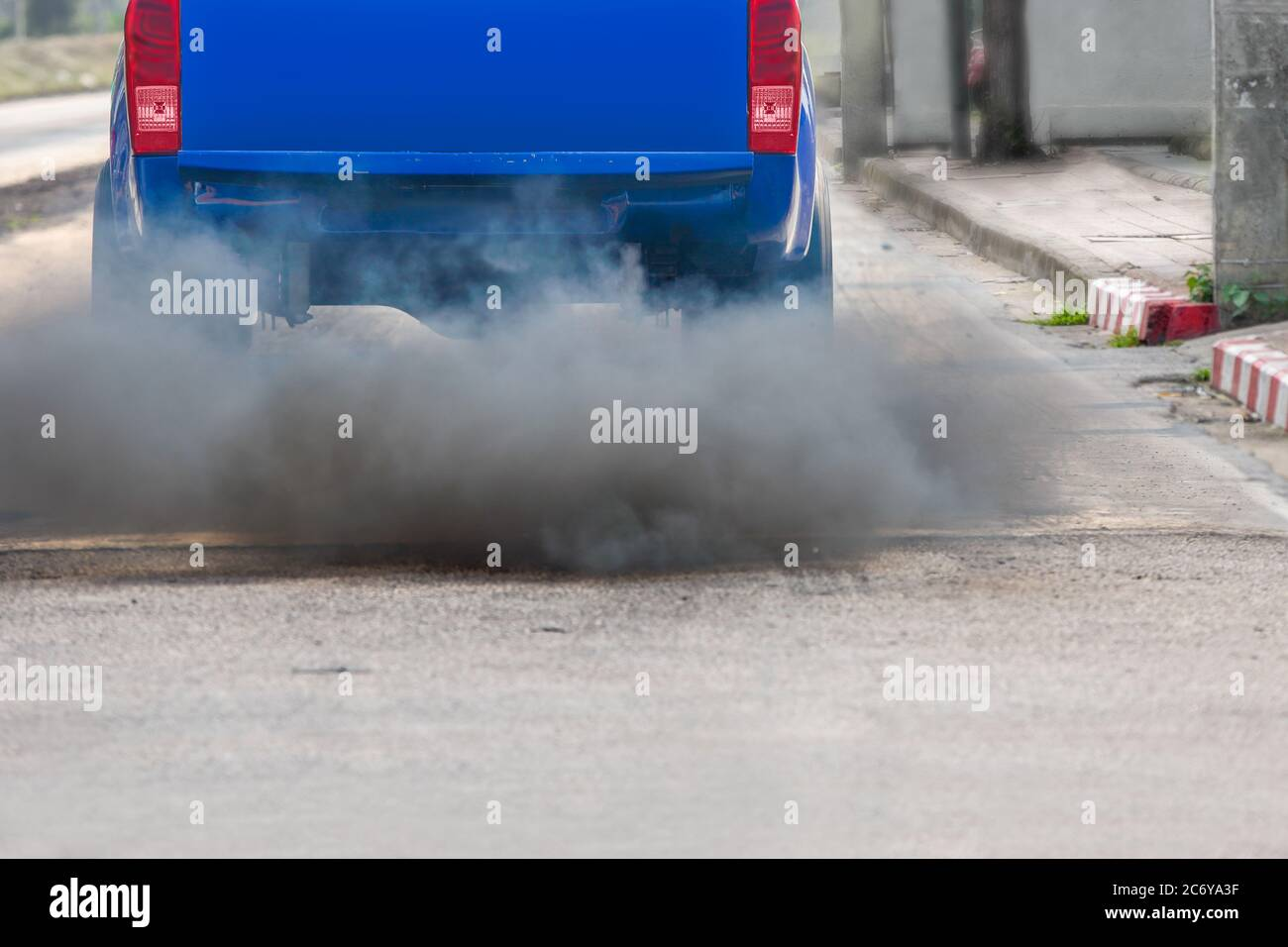 air pollution crisis in city from diesel vehicle exhaust pipe on road Stock Photo