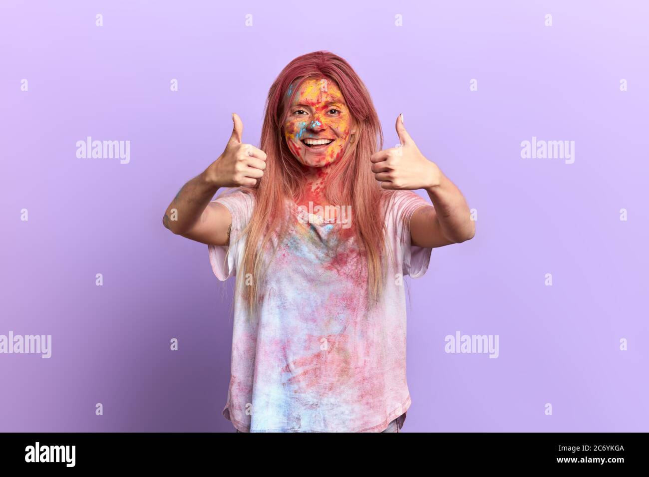 excited positive satisfied girl rejoicing at the color festival. close up portrait, isolated violet background, studio shot.gesture, symbol, body lang Stock Photo