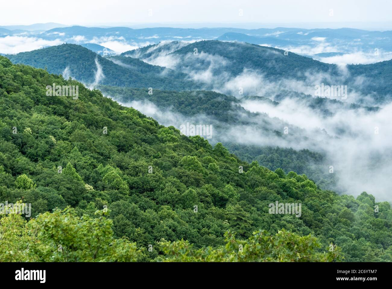 Blue Ridge Mountains scenic landscape of low-lying clouds drifting and climbing through mountain valleys in the North Georgia Mountains. (USA) Stock Photo