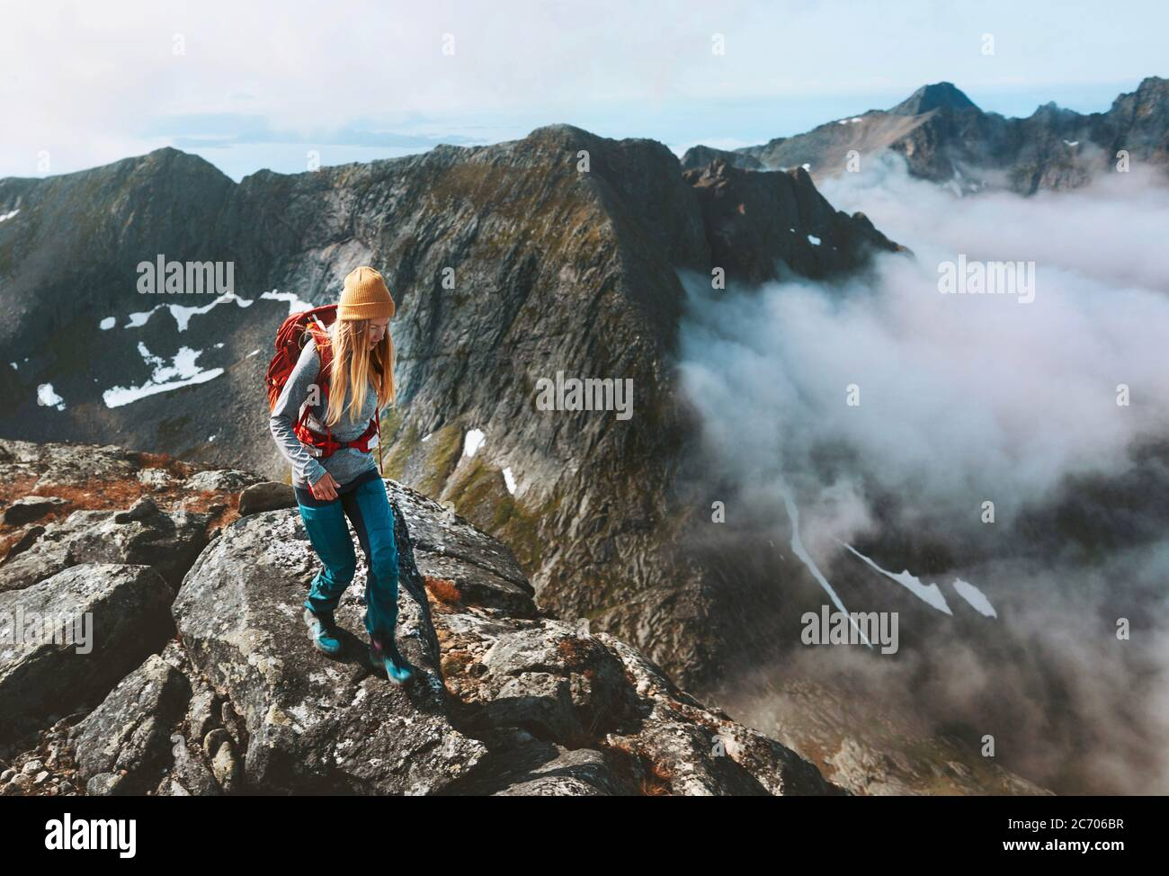 Hiking adventures woman trail running in mountains with backpack solo travel outdoor summer vacation trip in Norway healthy lifestyle concept Stock Photo