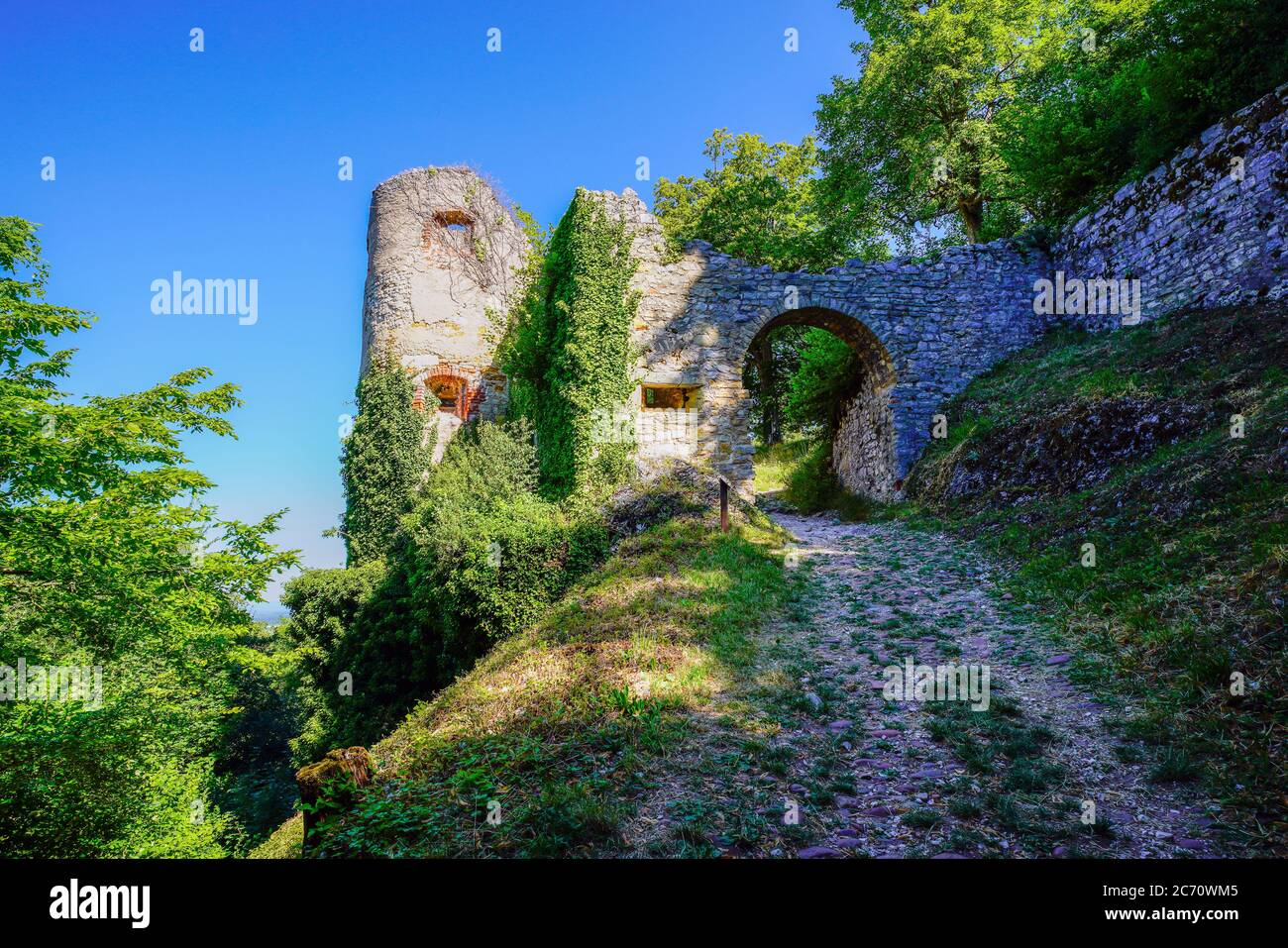 Gate to castle ruins in Ferrette, commune in the Haut-Rhin department in Alsace in north-eastern France. Stock Photo