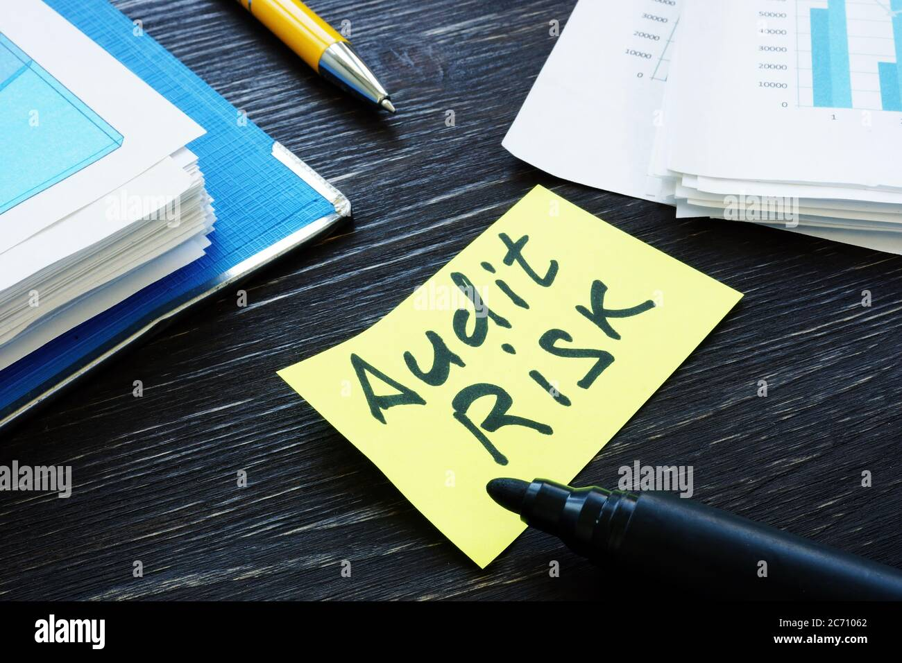 Audit risk memo and stack of papers with report. Stock Photo