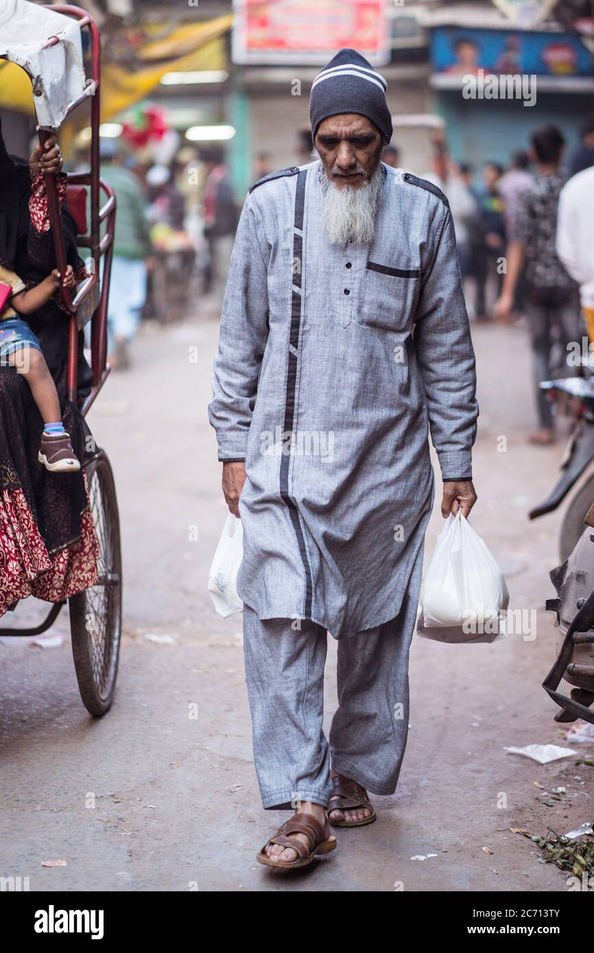 Old Man Carrying Bags High Resolution Stock Photography And Images Alamy