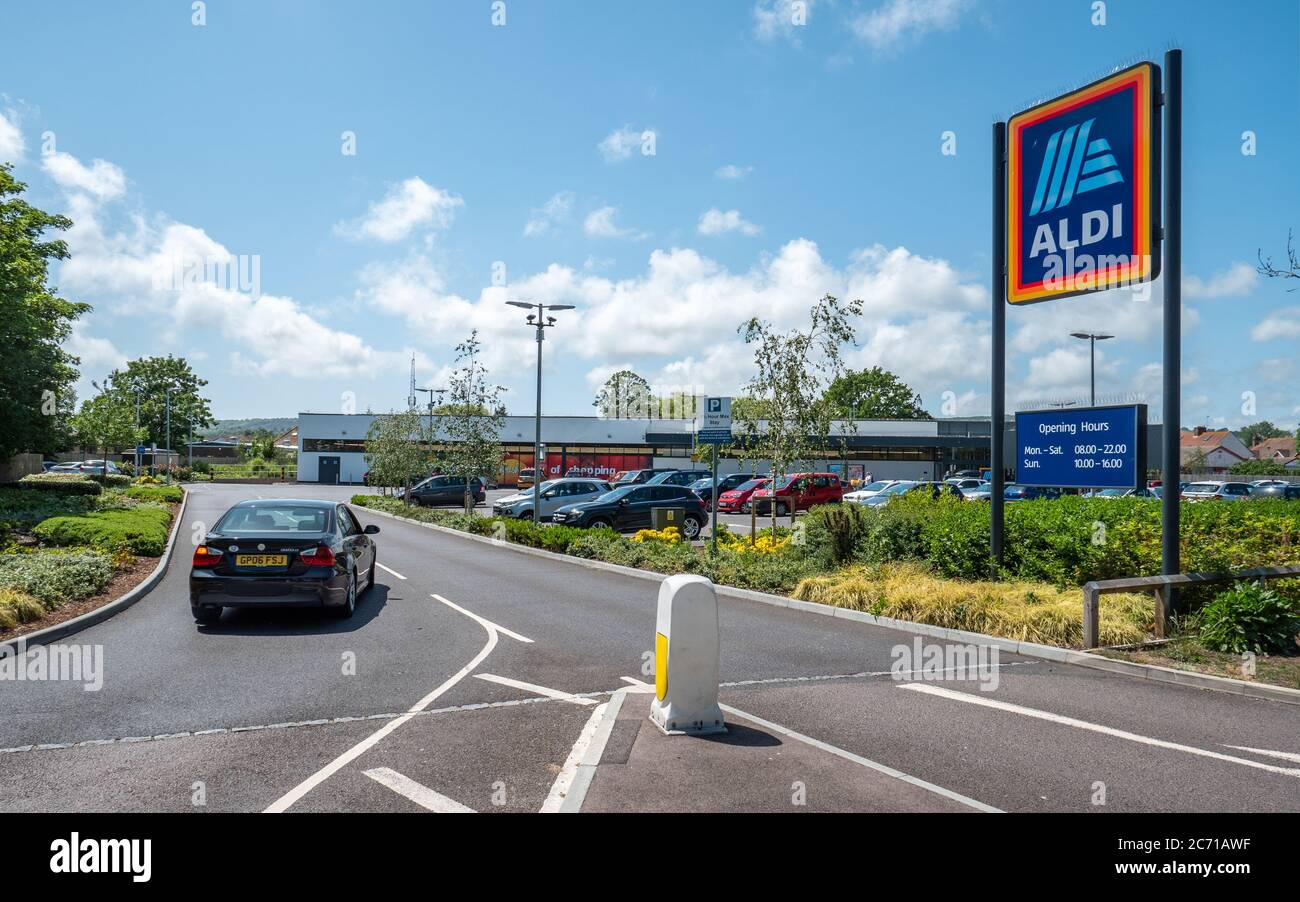 Aldi Supermarket. A car entering the supermarket retailer, Aldi, on a bright day in the East Sussex town of Eastbourne, England. Stock Photo