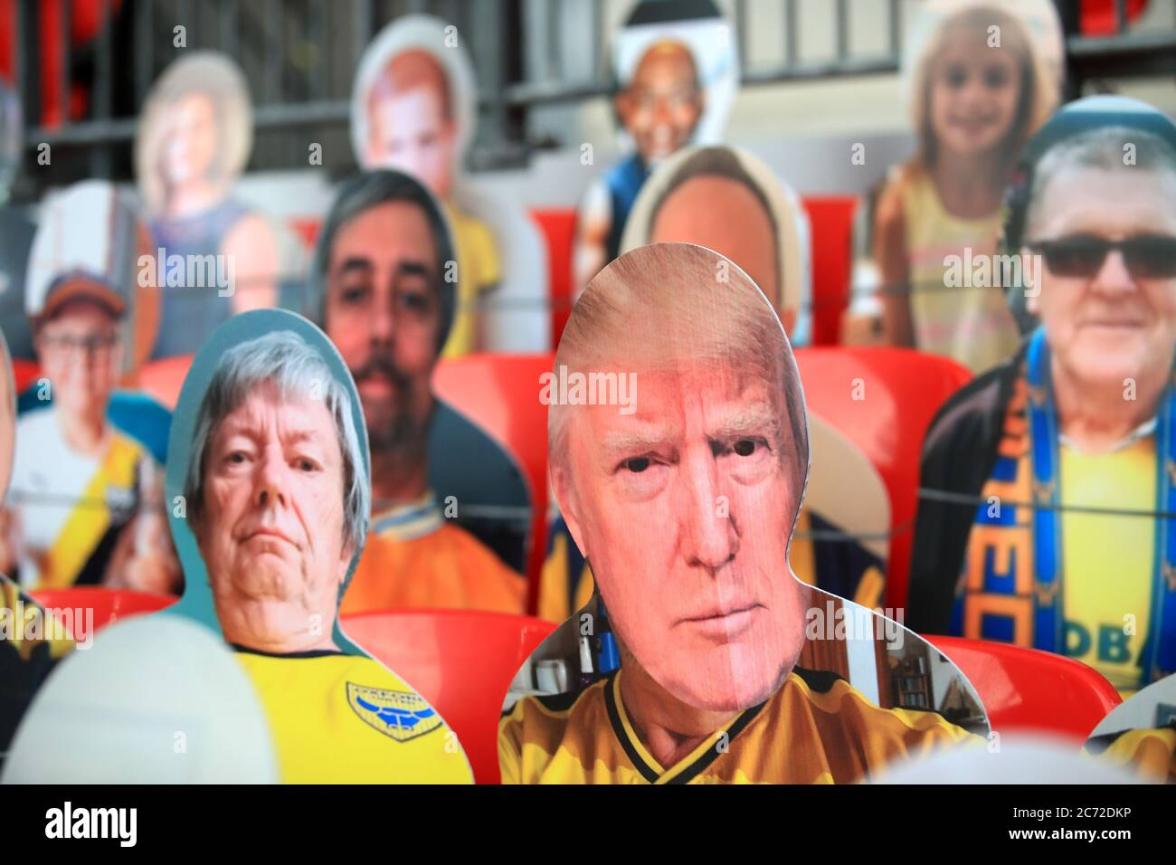 A general view of cardboard cut-out of fans in the stands including Donald Trump before the Sky Bet League One play-off final at Wembley Stadium, London. Stock Photo