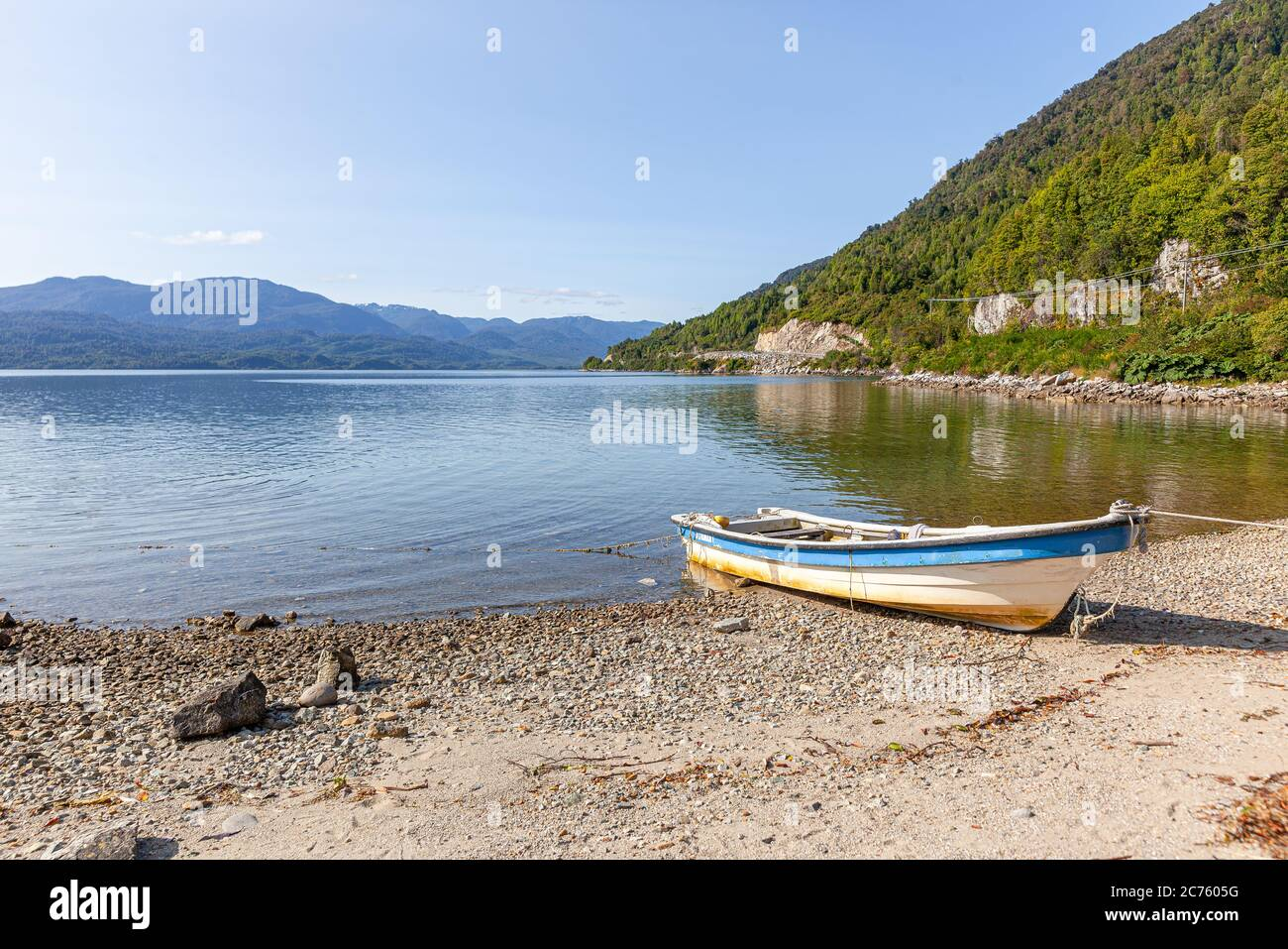 Boat anchored on the beach of the fjord of Puyuhuapi, Patagonia, Chile. Pacific Ocean Stock Photo