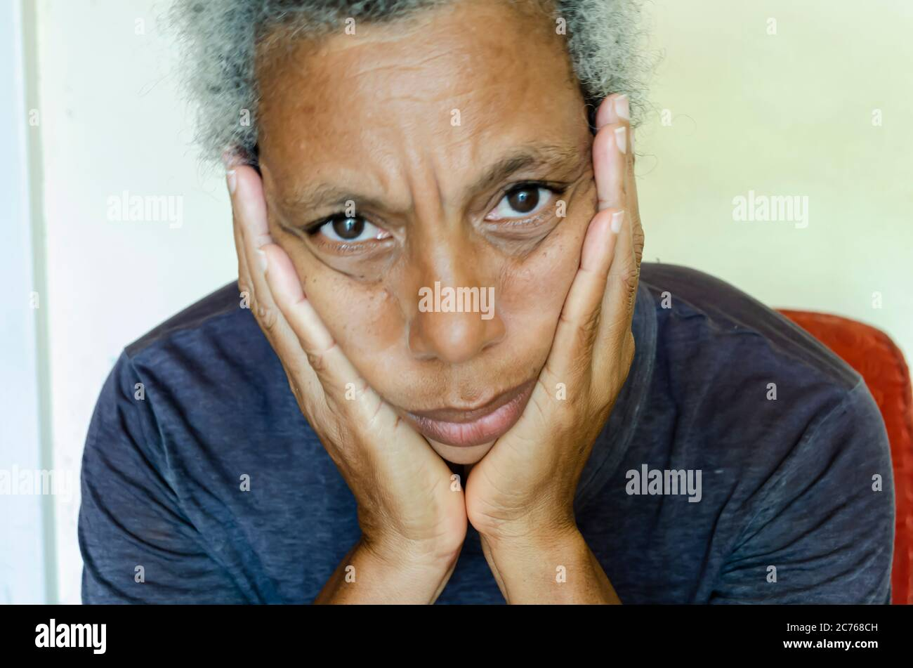Woman With Hands On Jaws Stock Photo