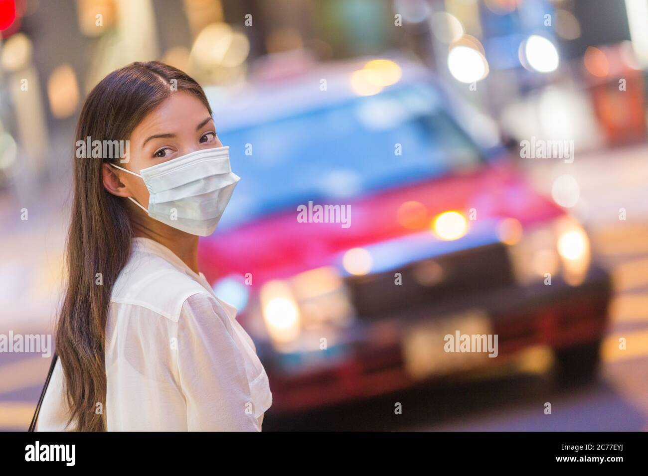 Flu disease virus spreading protection mask protective against influenza viruses and diseases. Asian woman wearing surgical mask on face in public Stock Photo