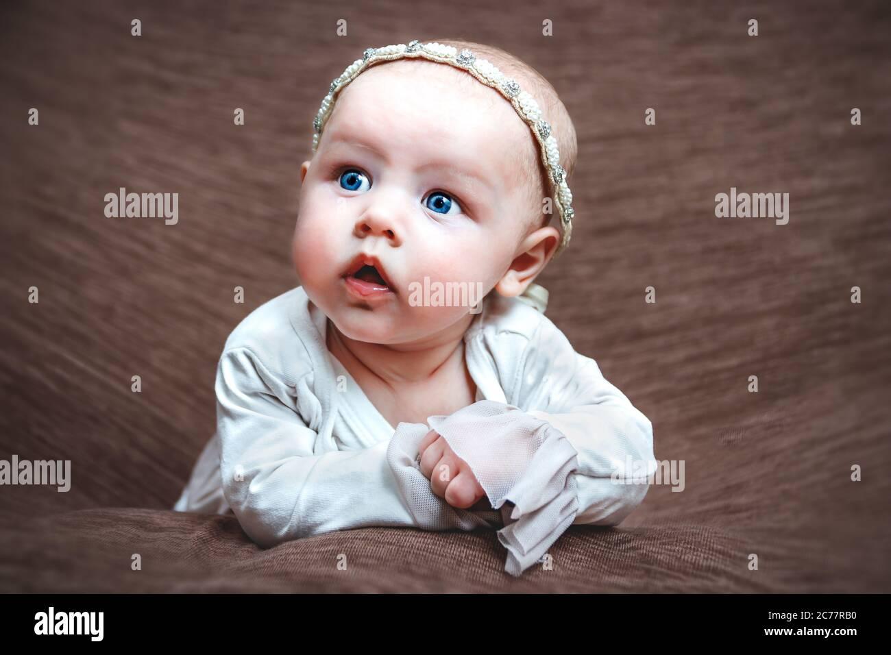 Baby girl closeup facial expression Stock Photo