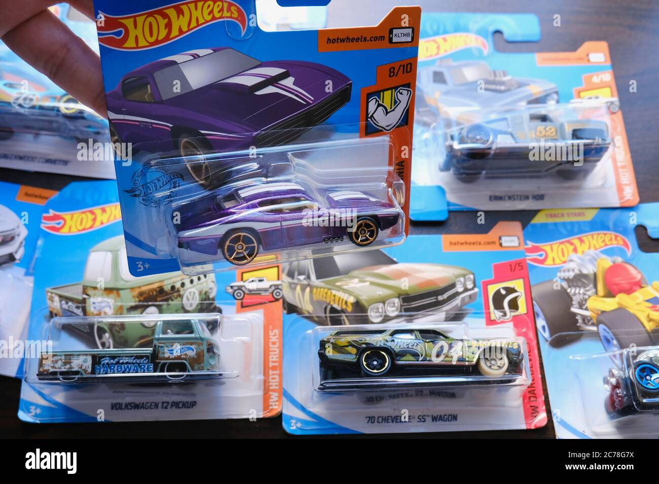 Istanbul, Turkey - July 12, 2020: A Hot Wheels purple American custom diecast toy car from Muscle Mania serie on hand and others at the background on Stock Photo