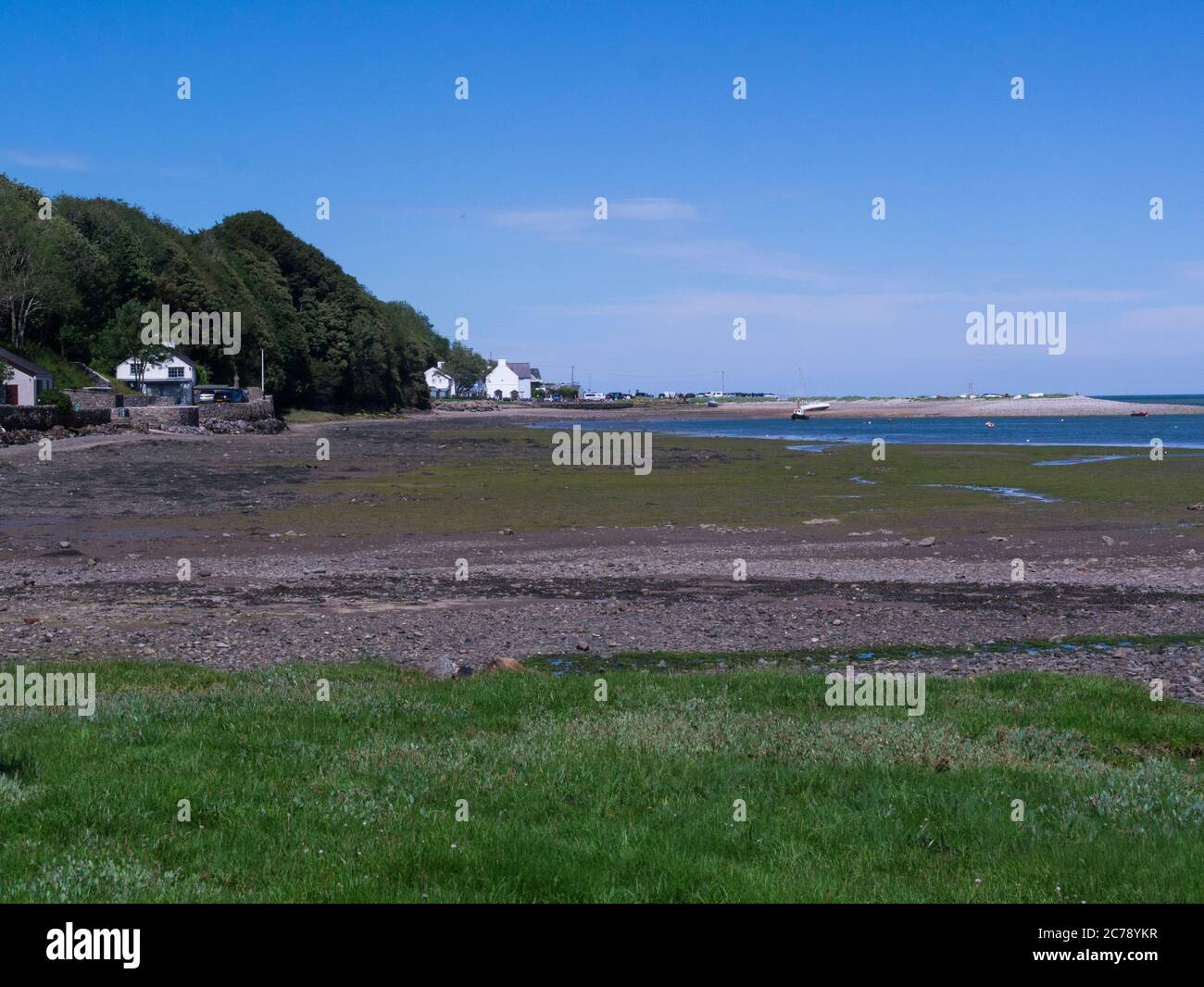 View across tyhe saltings towards Red Wharf Bay Isle of Anglesey North Wales UK at low tide on a lovely sunny July day weather Stock Photo