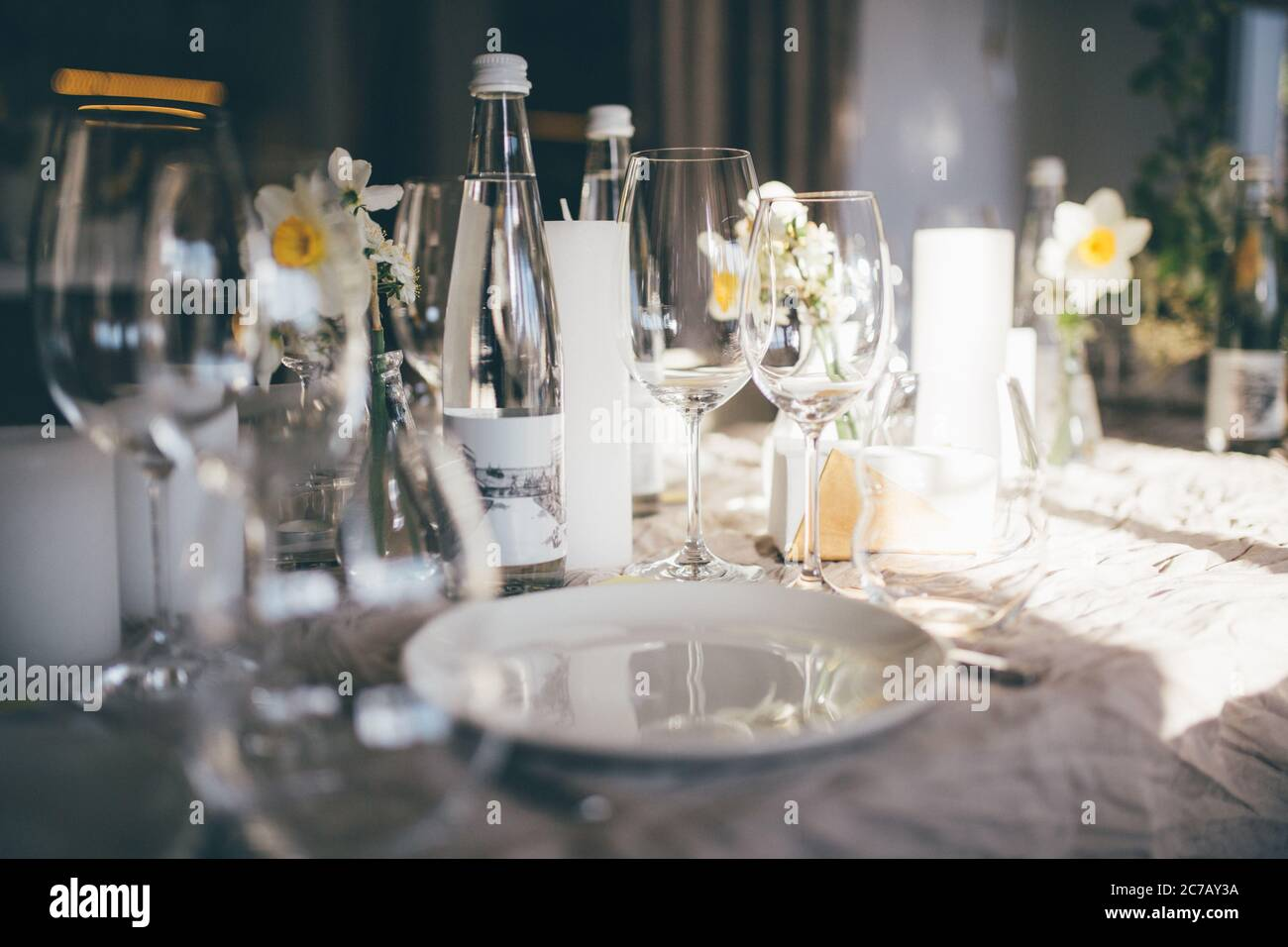 Table Setting For Dinner In Restaurant On The Sunset Served Wedding Table With Decor As Candles Flower Arrangements Wine Glasses Water Stock Photo Alamy