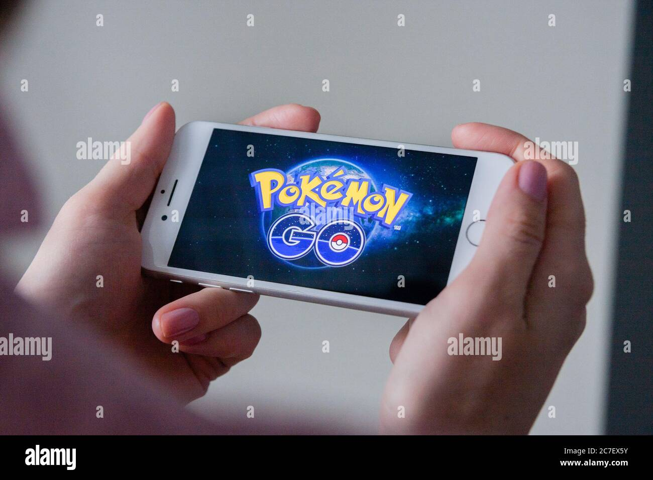 Los Angeles, California, USA - 8 March 2019: Hands holding a smartphone with Pokemon Go game on display screen, Illustrative Editorial Stock Photo