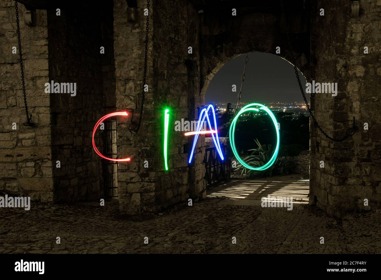 A horizontal shot of 'CIAO' illustration made with steel wool effect near a historical building in Brescia, Italy Stock Photo