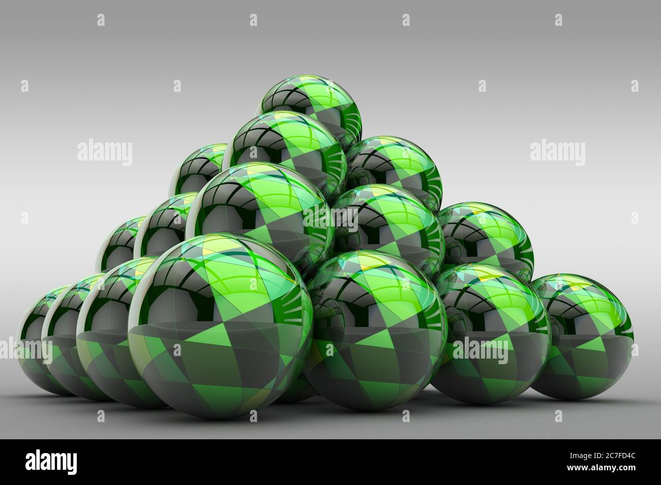 3D pyramid of spheres with a glossy finish and an abstract pattern in the form of geometric shapes Stock Photo