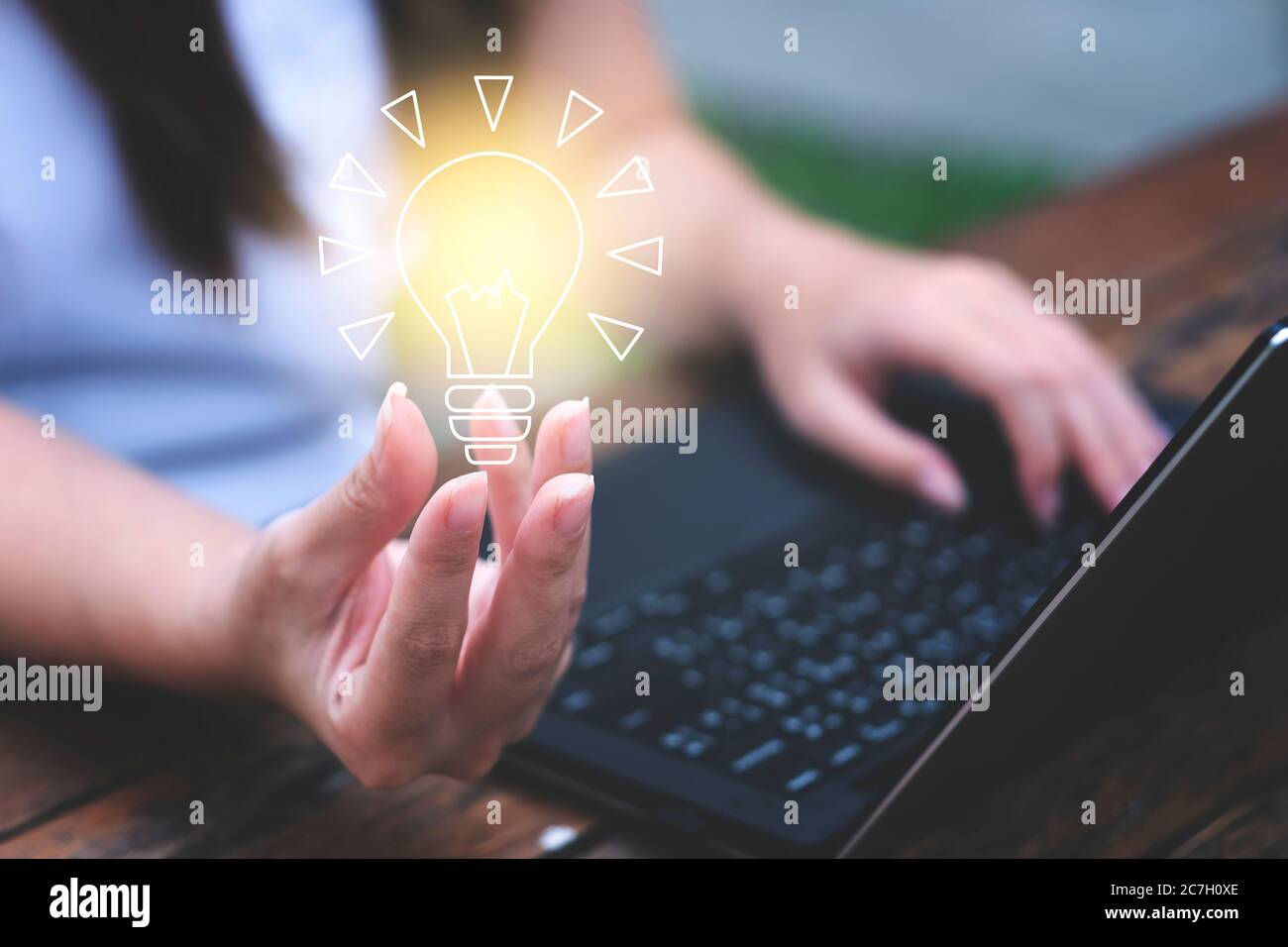 Young woman holding a light bulb. Get ideas, innovative technology and creativity concept Stock Photo