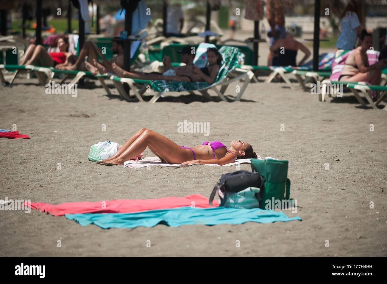 Malaga, Spain. 17th July, 2020. A woman is seen sunbathing at La Malagueta beach amid coronavirus crisis.The appearance of new coronavirus (COVID-19) outbreak in Spain after easing of restrictions has caused the regional government to impose the obligatory use of face masks in outdoors places even when they observe a safe distance between people. This measure tries to curb the spread of coronavirus pandemic. Credit: SOPA Images Limited/Alamy Live News Stock Photo