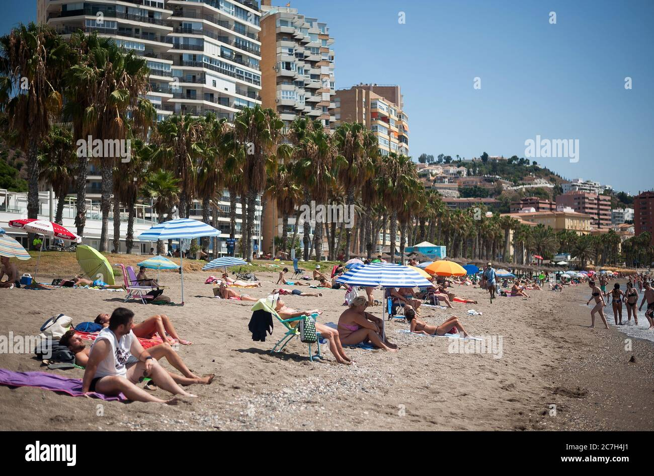 Malaga, Spain. 17th July, 2020. General view of La Malagueta beach as people sunbathe amid coronavirus crisis.The appearance of new coronavirus (COVID-19) outbreak in Spain after easing of restrictions has caused the regional government to impose the obligatory use of face masks in outdoors places even when they observe a safe distance between people. This measure tries to curb the spread of coronavirus pandemic. Credit: SOPA Images Limited/Alamy Live News Stock Photo