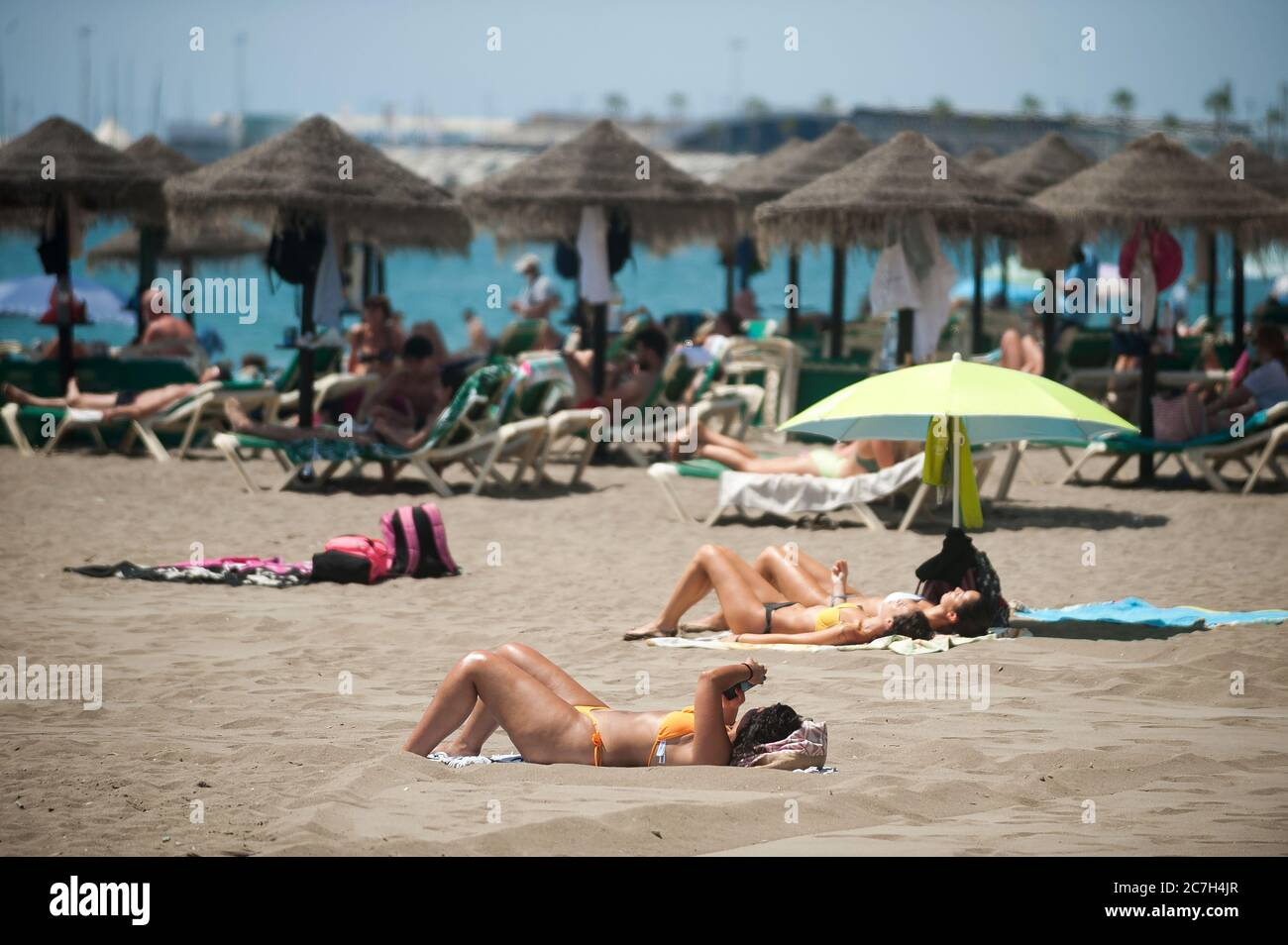 Malaga, Spain. 17th July, 2020. People are seen sunbathing at La Malagueta beach amid coronavirus crisis.The appearance of new coronavirus (COVID-19) outbreak in Spain after easing of restrictions has caused the regional government to impose the obligatory use of face masks in outdoors places even when they observe a safe distance between people. This measure tries to curb the spread of coronavirus pandemic. Credit: SOPA Images Limited/Alamy Live News Stock Photo