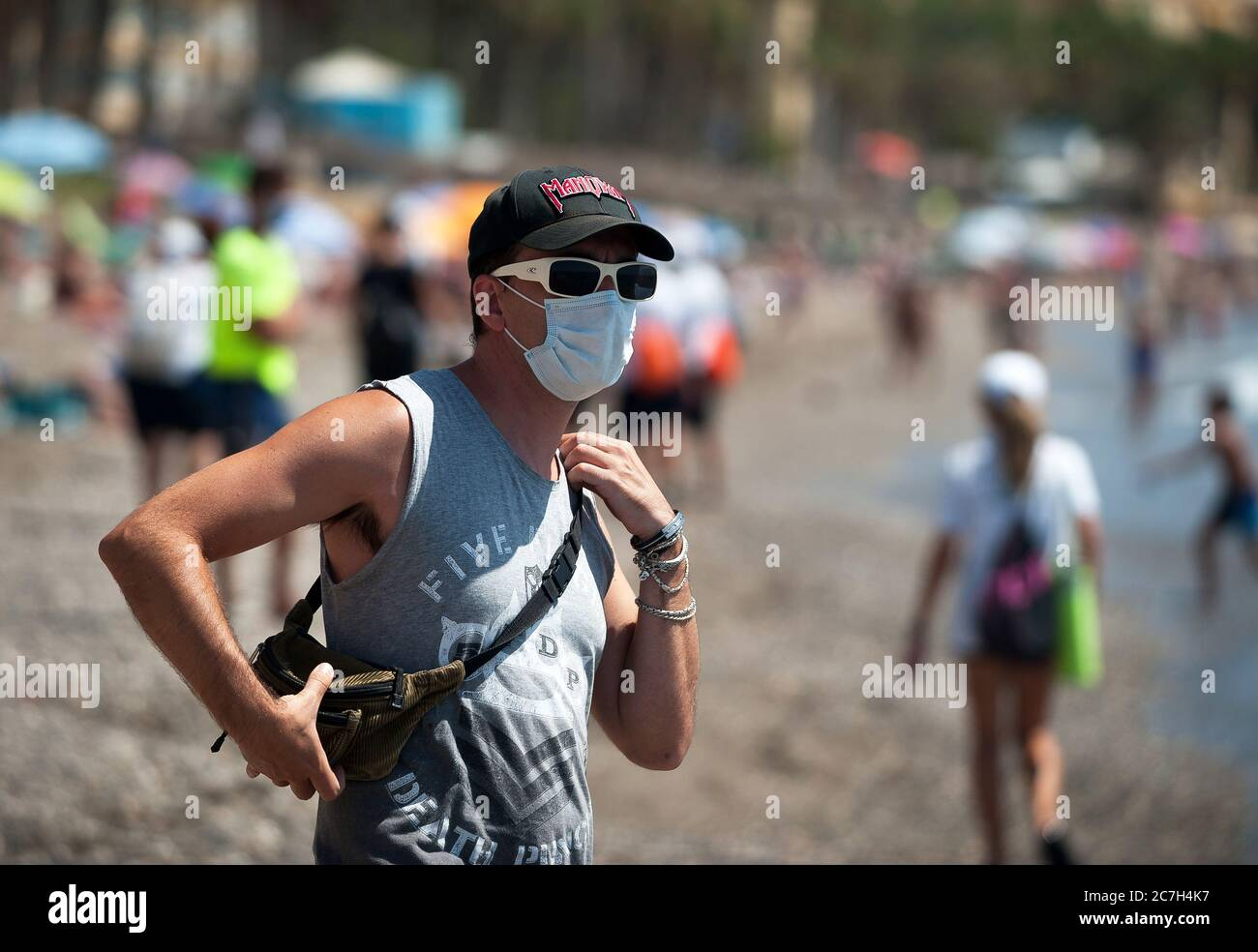 Malaga, Spain. 17th July, 2020. A man wearing a face mask is seen at La Malagueta beach amid coronavirus crisis.The appearance of new coronavirus (COVID-19) outbreak in Spain after easing of restrictions has caused the regional government to impose the obligatory use of face masks in outdoors places even when they observe a safe distance between people. This measure tries to curb the spread of coronavirus pandemic. Credit: SOPA Images Limited/Alamy Live News Stock Photo