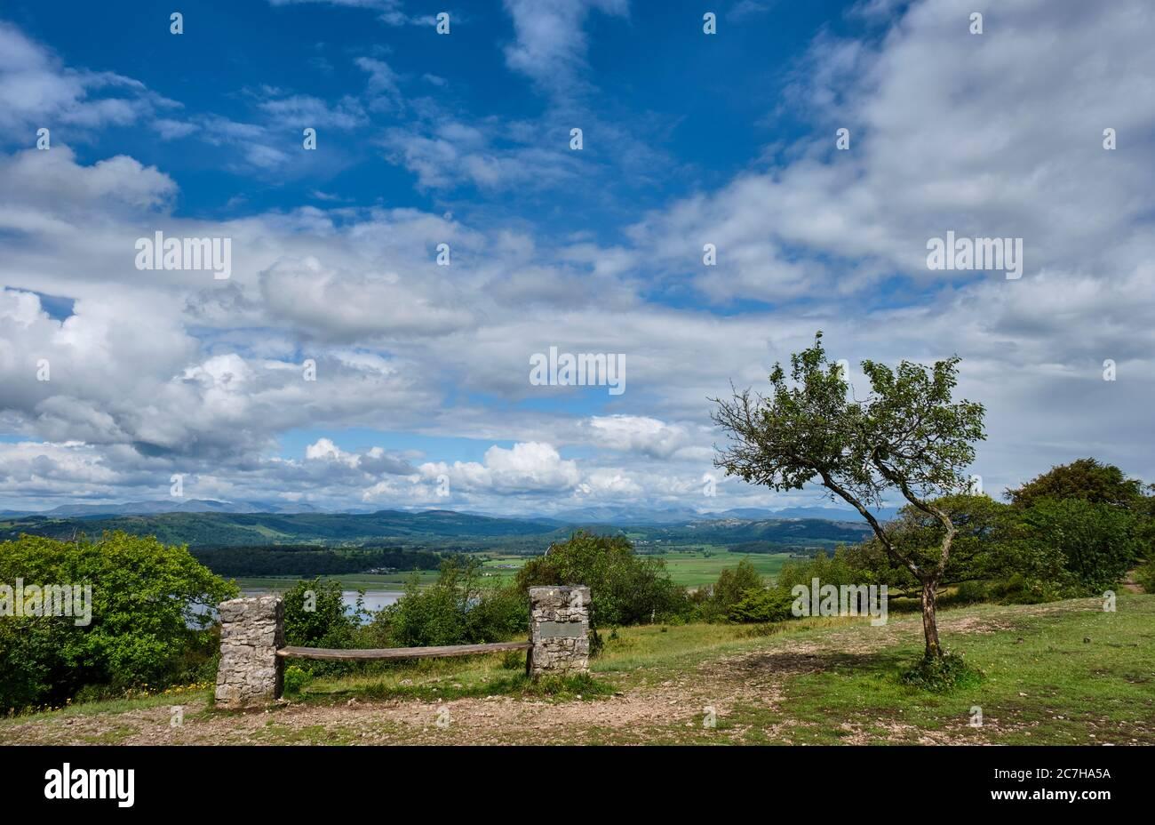 Bench overlooking the Lake District on Arnside Knott, Arnside, Cumbria Stock Photo