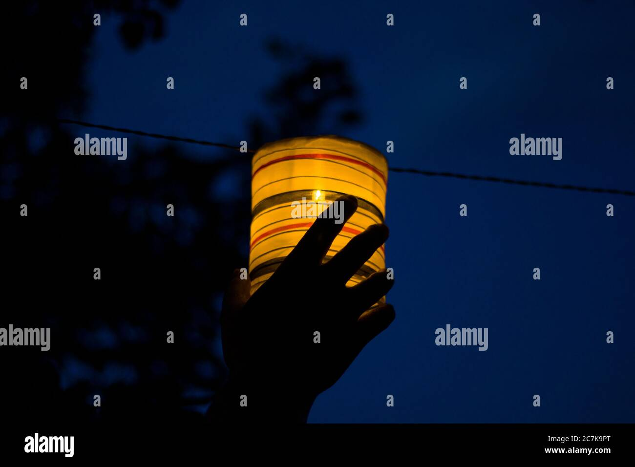 Lantern in the yard, night and warm light, hanging lanterns, natural light, evening time. Stock Photo