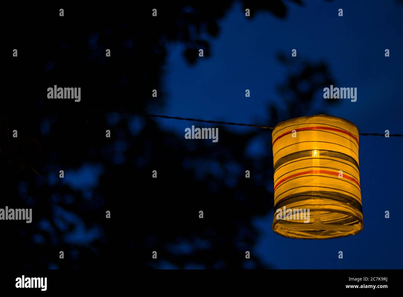 Lantern in the yard, night and warm light, hanging lanterns, natural light, evening time. Stock Photo