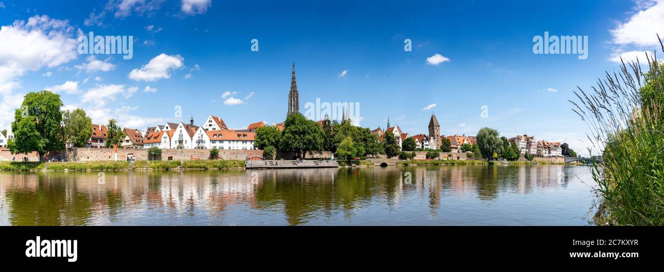 A panorama view of the city of Ulm in southern Germany with the Danube River in front Stock Photo