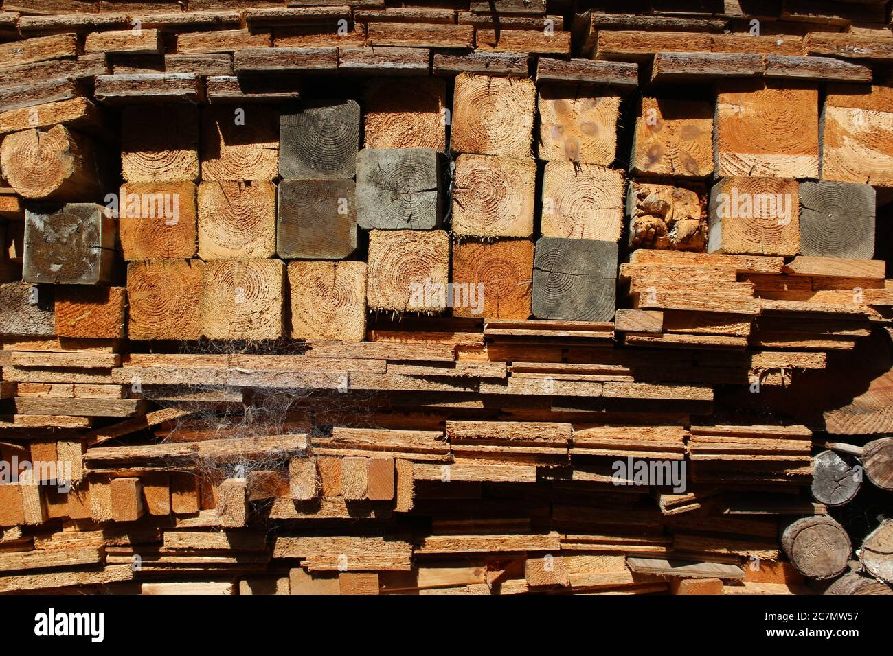 A pile of processed wood intended to serve as firewood / burning material Stock Photo
