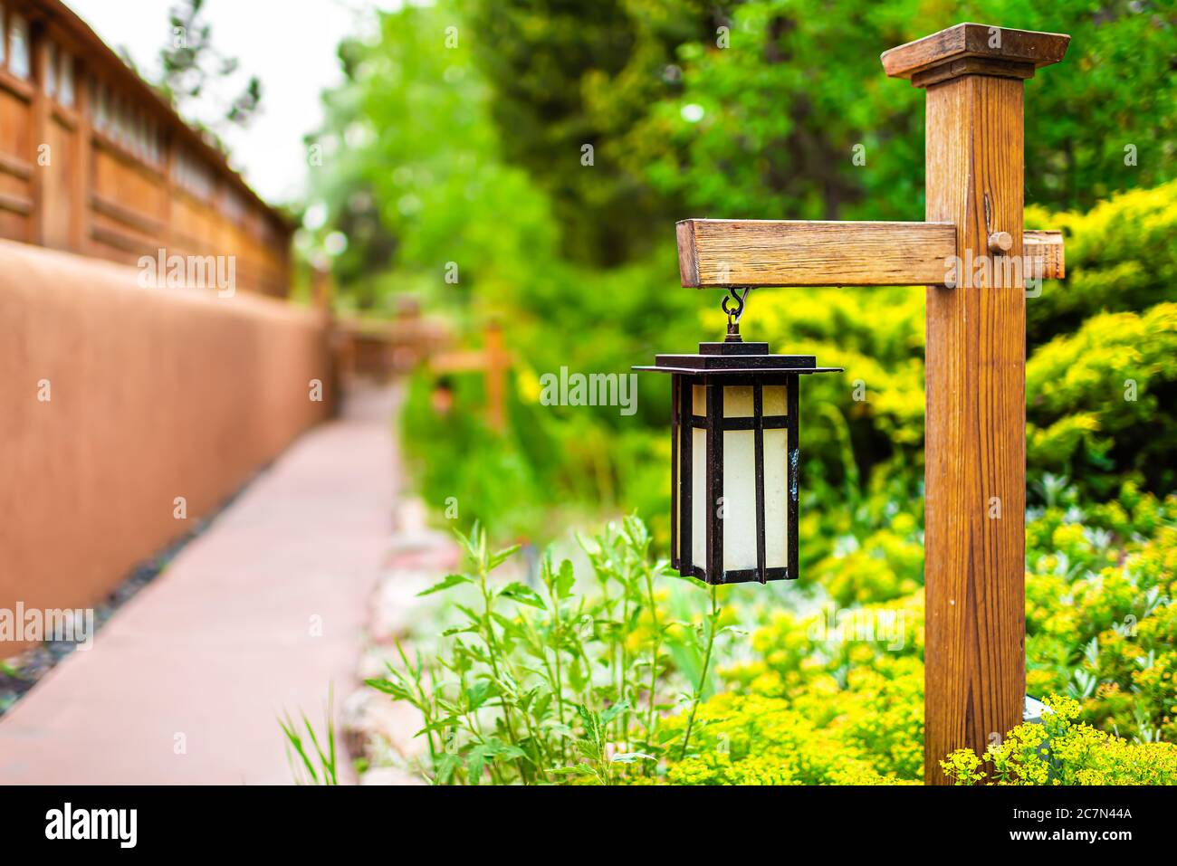 Japan Hanging Lantern Lamp Light On Wooden Post In Japanese Garden With Path By House Temple And Green Foliage Background Stock Photo Alamy
