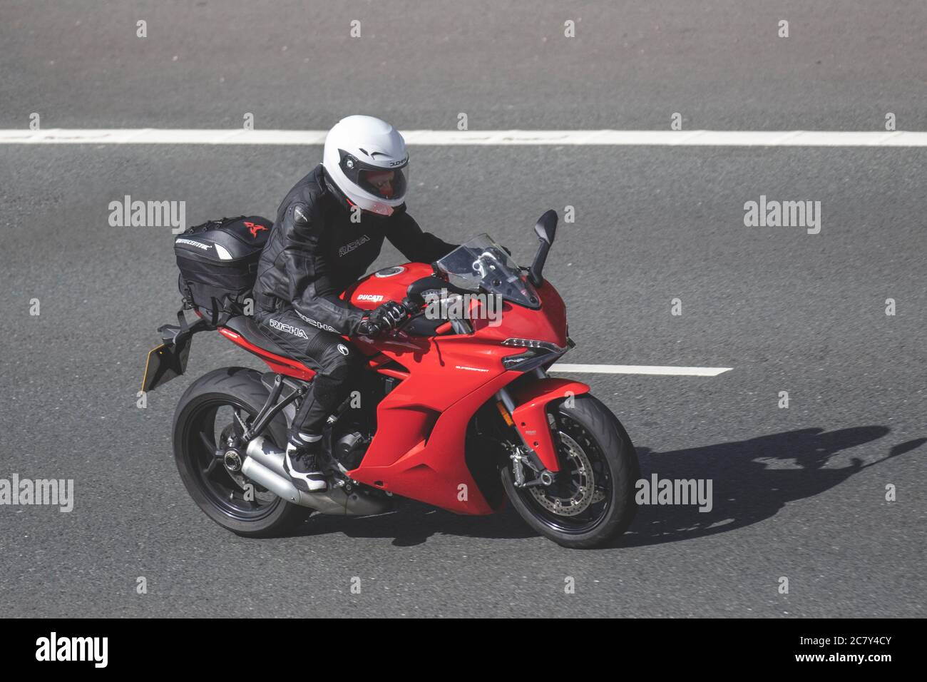 Ducati supersports motorcycle; Motorbike rider, two wheeled transport, motorcycles, vehicle, roads, motorbikes, bike riders motoring in Chorley, UK Stock Photo