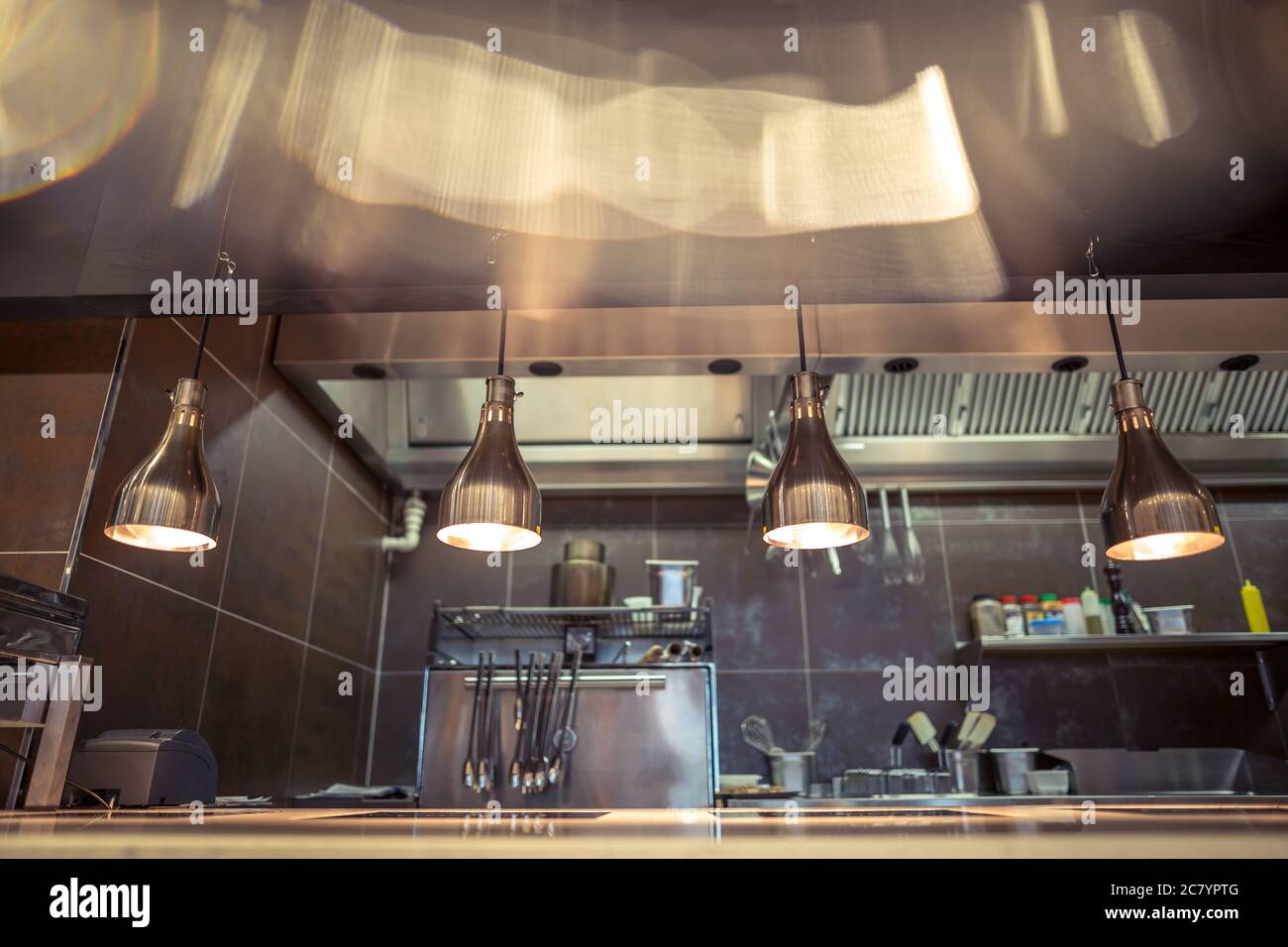 Restaurant Kitchen Interior Bar Counter Made Of Natural Stone Fences Off The Open Kitchen And Hall For Visitors With Tables And Chairs In The Backg Stock Photo Alamy
