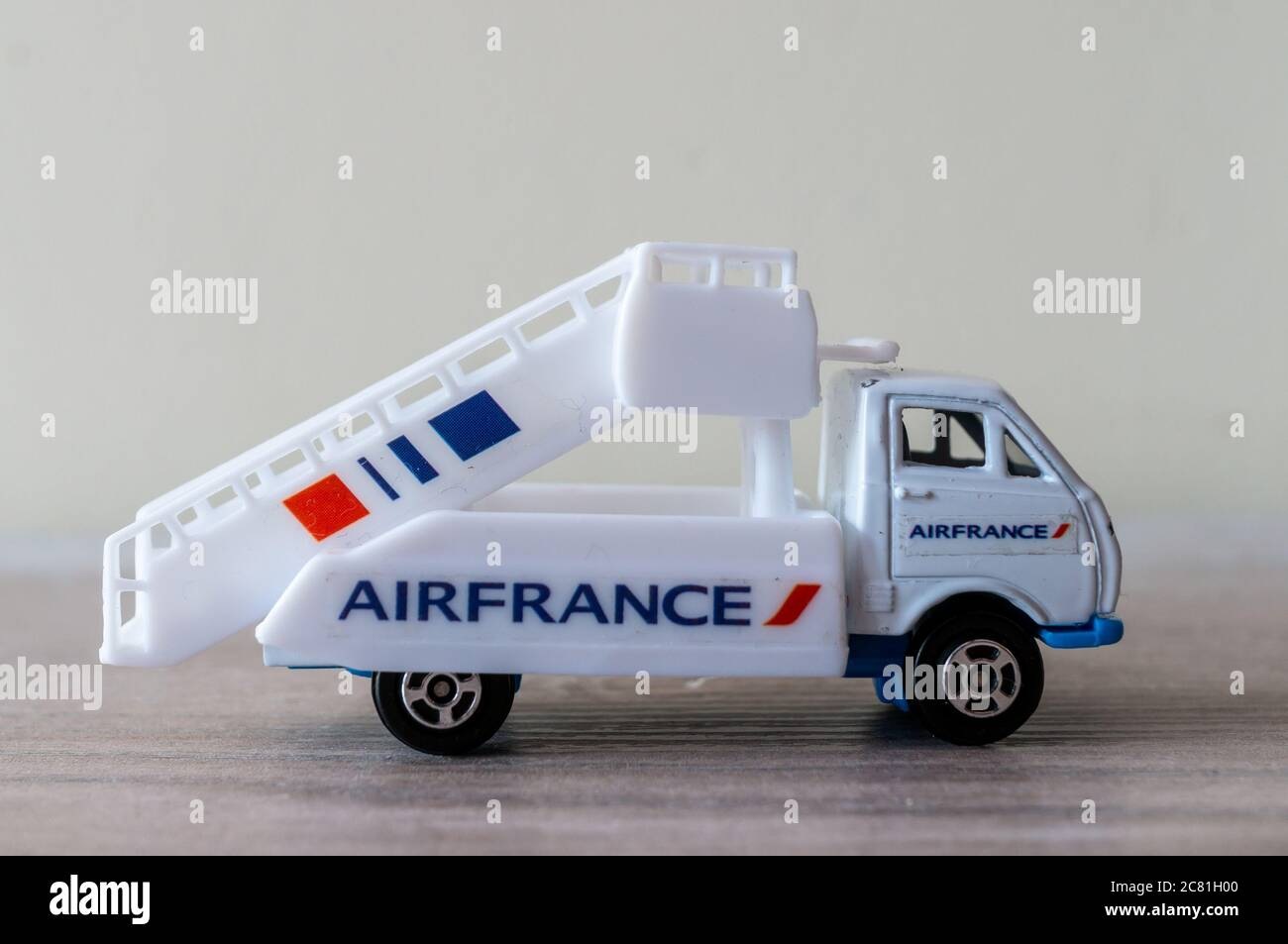 POZNAN, POLAND - Jun 28, 2020: Welly Airfrance airport truck on a wooden surface Stock Photo