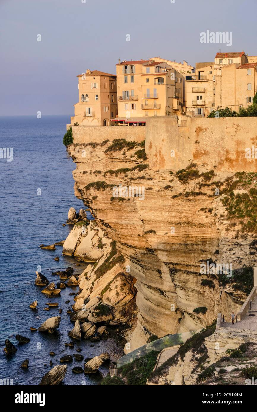The fortified old town of Bonifacio is perched on top of limestone cliffs eroded by the waves below to create the natural ledge high above the sea. Stock Photo