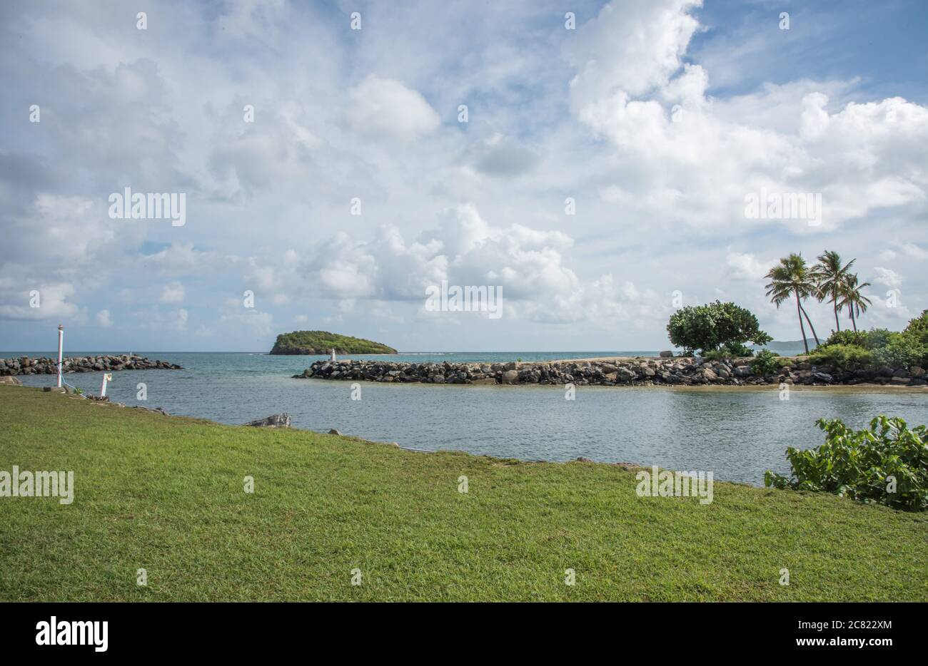 Groyne at Green Cay Marina entrance with island view in the Caribbean Sea on St. Croix in the USVI Stock Photo
