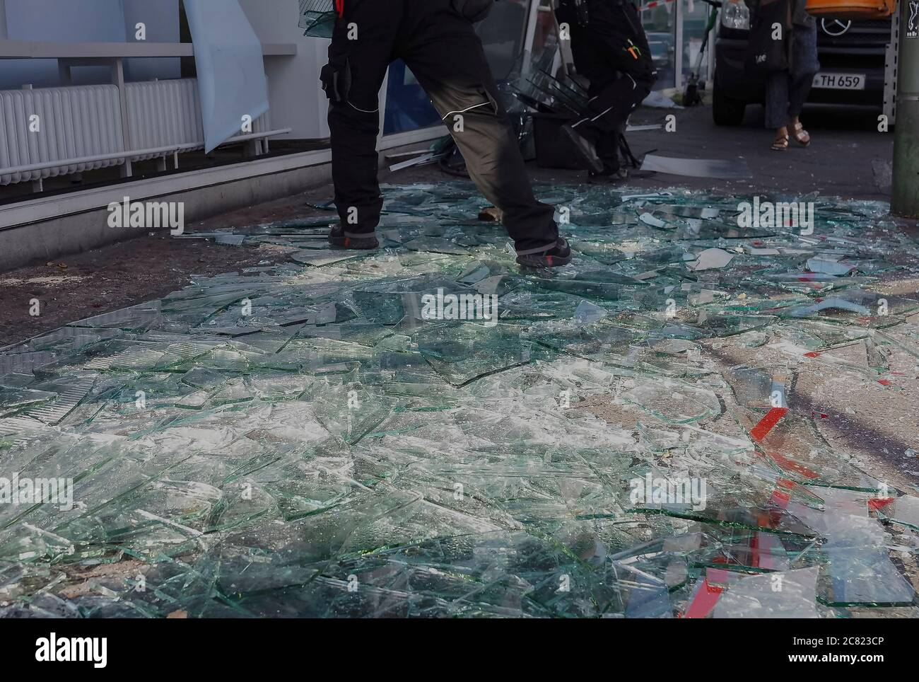 Berlin, Germany. 31st Dec, 2018. Shards of broken glass lie in front of a bank in the Gesundbrunnen. A gust of wind had literally pushed the glass facade of a bank outwards. Credit: Paul Zinken/dpa/Alamy Live News Stock Photo
