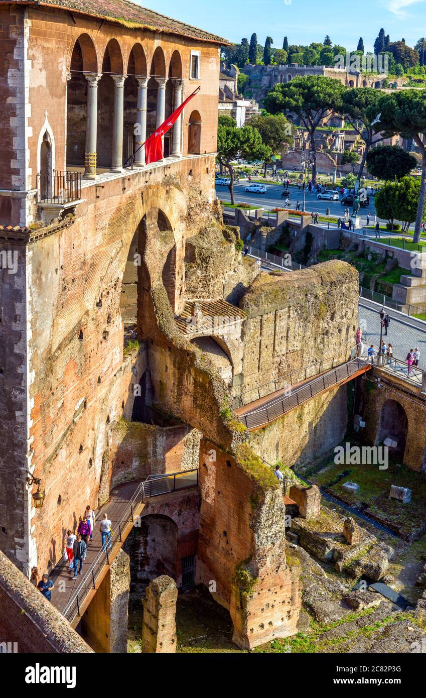 Rome - May 8, 2014: People visit House of Knights of Rhodes on Forum of Augustus, Rome, Italy. Old famous building in Roma center, tourist attraction Stock Photo