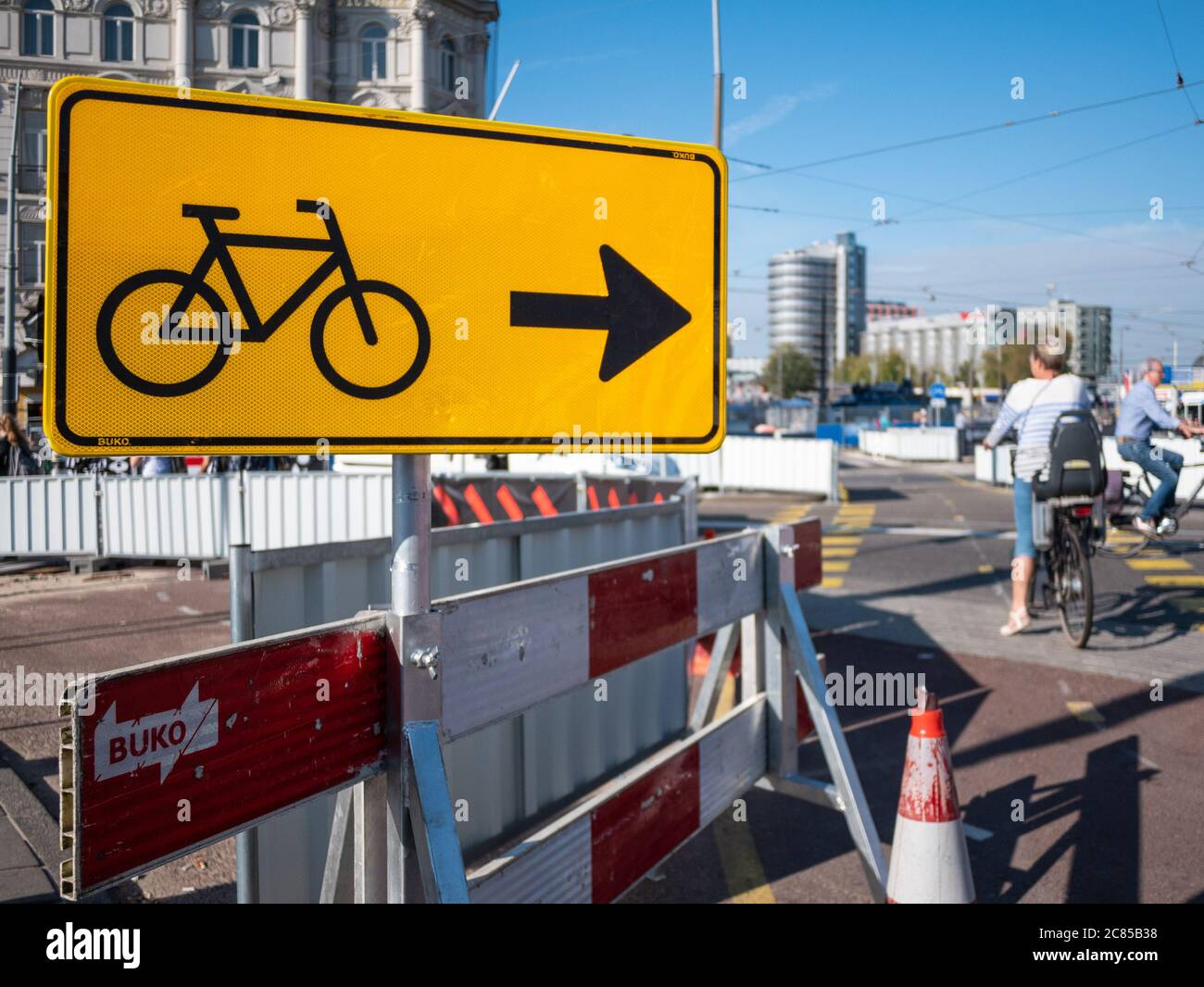 Amsterdam, Netherlands - October 15 2018: Yellow street signs directs cyclists which way to travel through the city centre Stock Photo