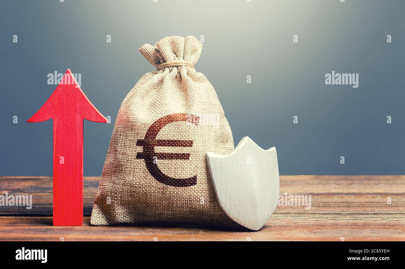 Euro money bag with a shield and a red arrow up. Increasing the maximum amount of guaranteed insurance compensation for deposits. Financial system sta Stock Photo