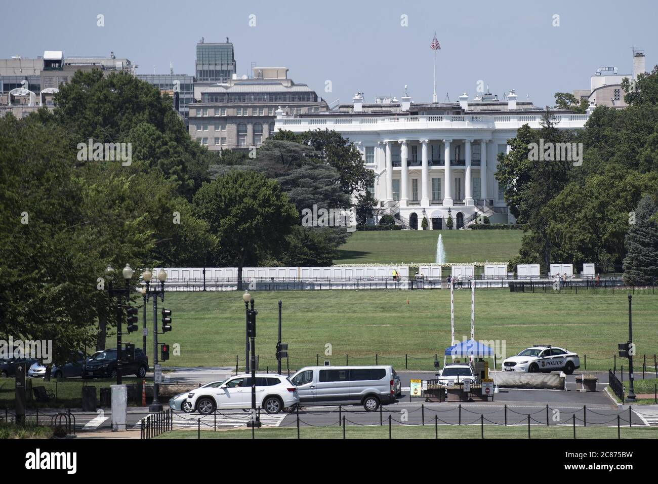 "Washington, USA. 21st July, 2020. Photo taken on July 21, 2020 shows the White House in Washington, DC, the United States. U.S. President Donald Trump said Tuesday afternoon that the coronavirus pandemic in the United States will probably ""get worse before it gets better."" More than 3.8 million people in the United States have infected with the virus, with more than 141,000 deaths, according to a count by Johns Hopkins University, as some states, including Florida, are seeing a surge in cases. Credit: Liu Jie/Xinhua/Alamy Live News Stock Photo"