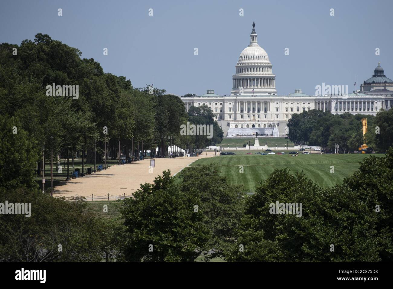 "Washington, USA. 21st July, 2020. Photo taken on July 21, 2020 shows the U.S. Capitol Building in Washington, DC, the United States. U.S. President Donald Trump said Tuesday afternoon that the coronavirus pandemic in the United States will probably ""get worse before it gets better."" More than 3.8 million people in the United States have infected with the virus, with more than 141,000 deaths, according to a count by Johns Hopkins University, as some states, including Florida, are seeing a surge in cases. Credit: Liu Jie/Xinhua/Alamy Live News Stock Photo"
