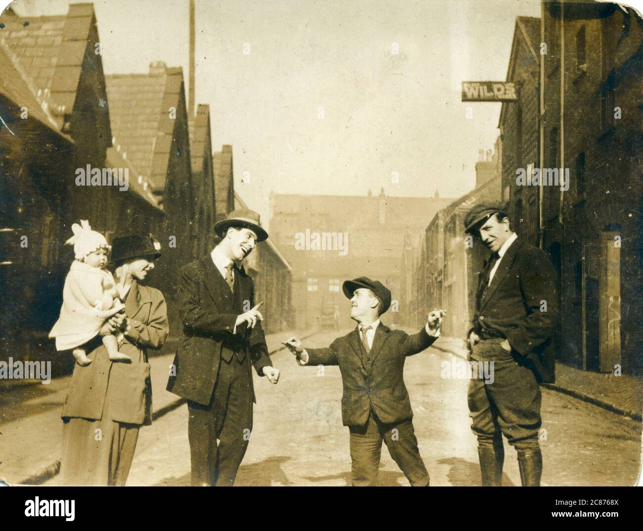 Group of people, possibly family members, including a man of restricted growth (dwarfism), 1920s.     Date: 1920s Stock Photo
