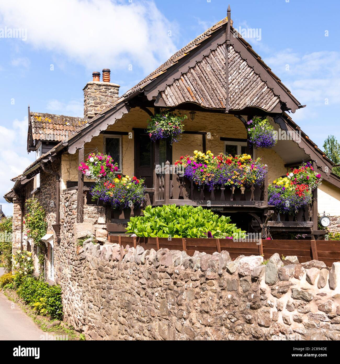 A Swiss chalet style balcony on an old stone cottage on Exmoor National Park in the village of Bossington, Somerset UK Stock Photo