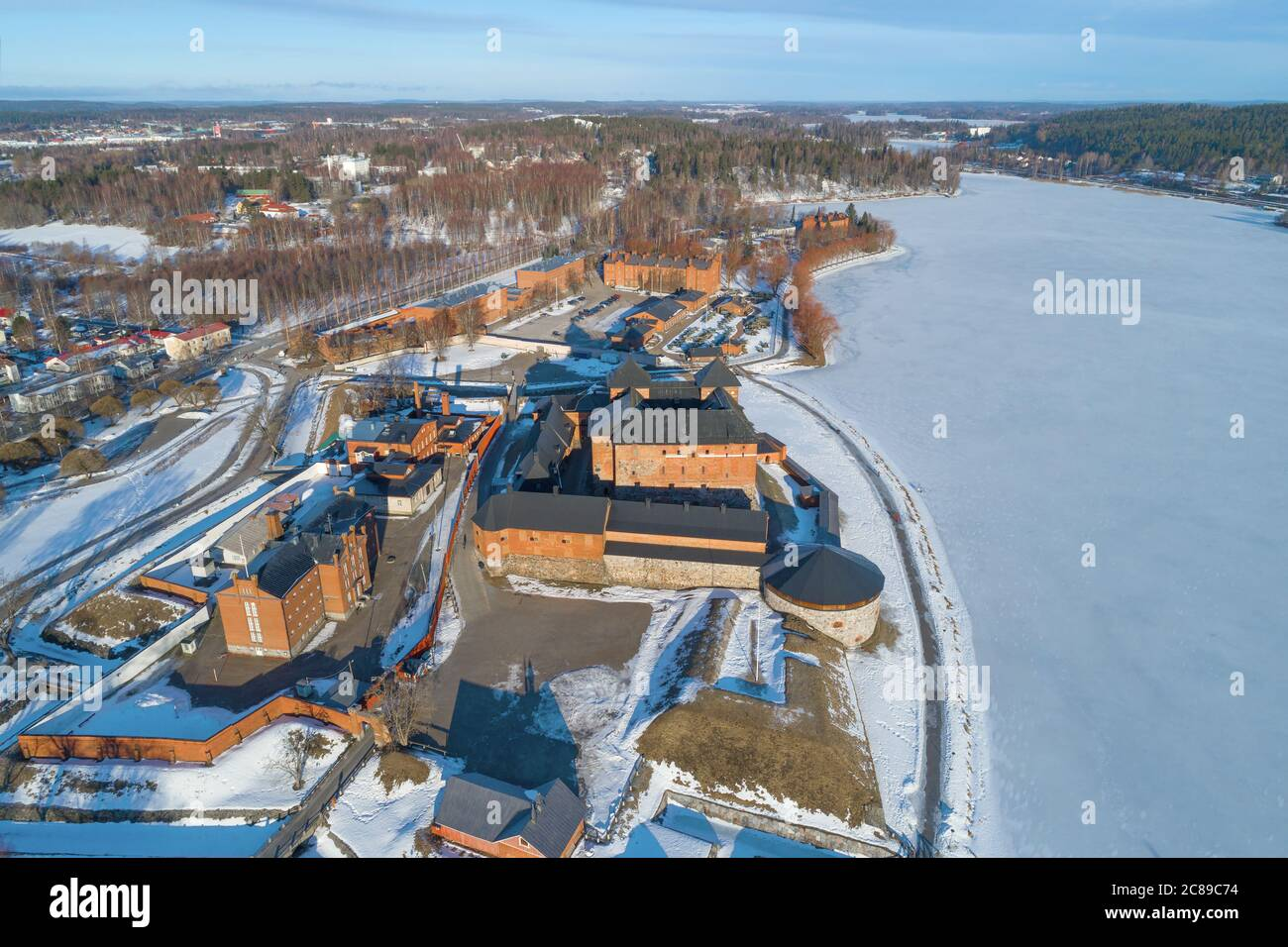 Above the old fortress-prison Hameenlinna on a sunny March day (aerial photography). Finland Stock Photo