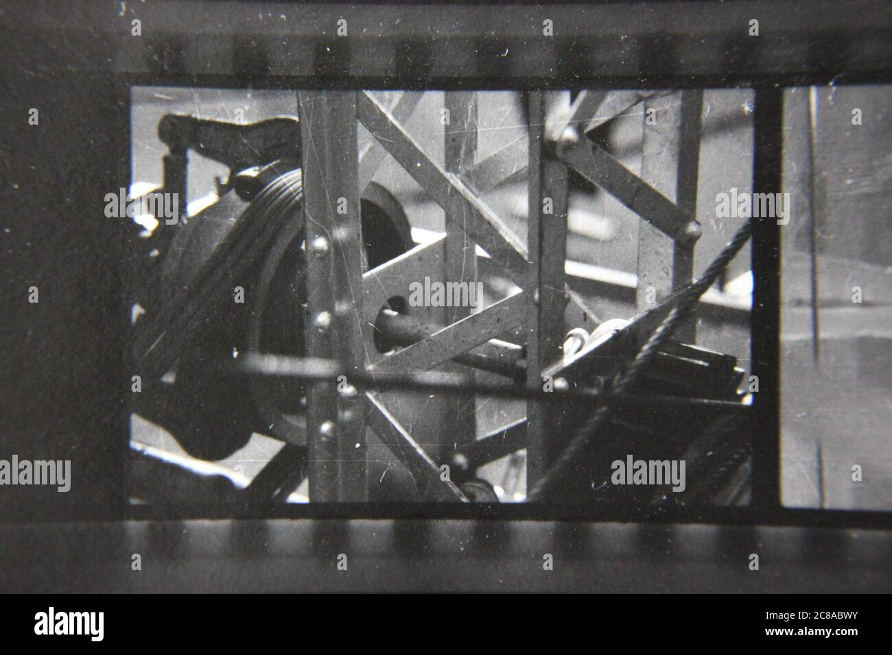 Fine 70s vintage contact print black and white photography of metal scaffold framework. Stock Photo