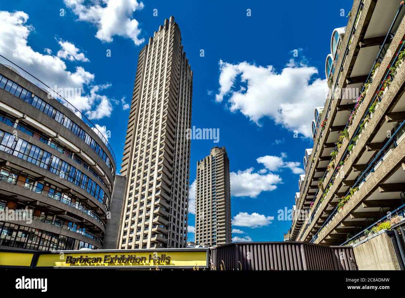 Residential high-rise blocks Shakespeare Tower and Lauderdale Tower, Frobisher Crescent and Ben Jonson House at brutalist Barbican Estate, London, UK Stock Photo